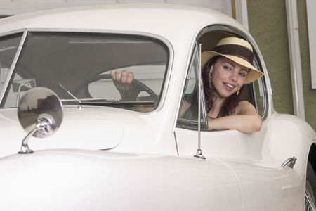 highfashion: Beautiful woman behind the wheel of a classic Jaguar car