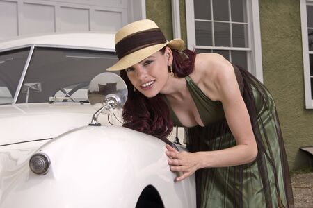 highfashion: Beautiful woman checks out her look in the sideview mirror of a classic Jaguar car.