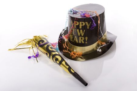 Top hat that says happy new year and other party favors isolated against white background photo