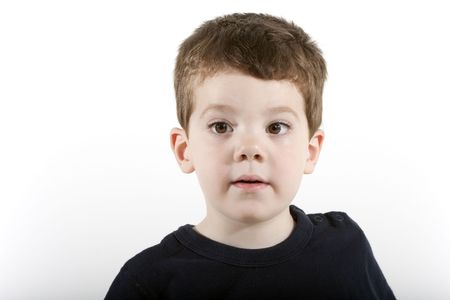 Head and shoulders portrait of a young boy of preschool age Imagens