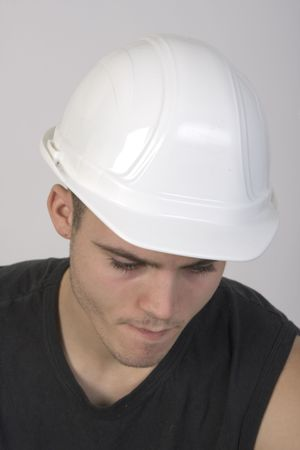CLoseup portrait of a handsome young man wearing a hardhat