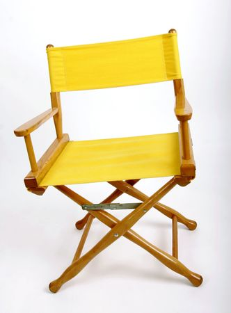 filmmaker: Yellow directors chair against a white background Stock Photo