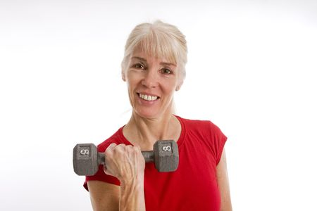 Middle-aged woman working with barbell isolated against white background Reklamní fotografie