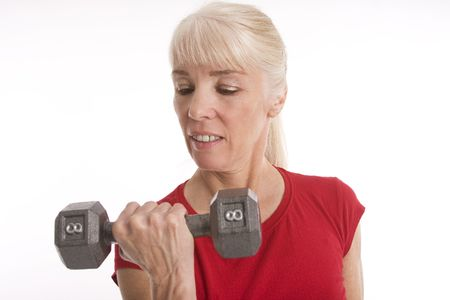 Attractive middle-aged woman working out against isolated white background