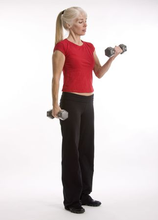 Middle-agred woman working out with weight isolated against white background Reklamní fotografie