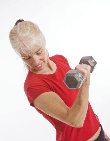 Middle-aged woman working out with small barbell isolated against white background Reklamní fotografie