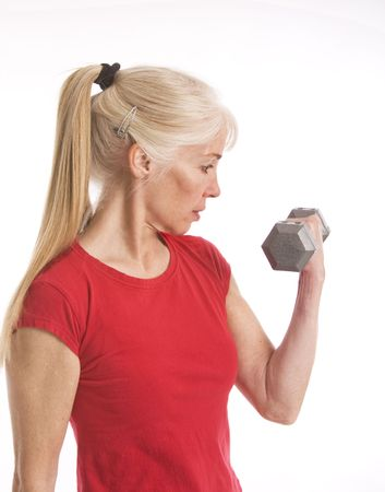 Middle-aged woman lifting small barbell isolated against white background