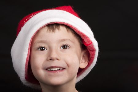 Portrait of a young boy dressed in a red Santa Claus hat Reklamní fotografie