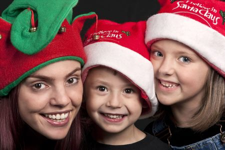 Portrait of a mother, son and daughter dressed in Christmas hats Reklamní fotografie