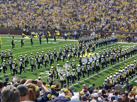 The University of Michigan Marching Band takes the field at the Big House in Ann Arbor, Michigan, for the 2011 football season opener against Western Michigan University.