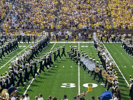 The University of Michigan Marching Band forms the Block M on the field at the Big House in Ann Arbor, Michigan, during the 2011 football season opener against Western Michigan University.