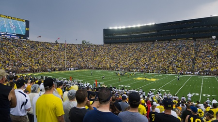 University of Michigan football team faces off against Western Michigan Unversity at its season opener on Saturday, Sept. 3, 2011, in the Big House in Ann Arbor, Michigan. The Wolverines won 34-10 in a game cut short by severe thunderstorms. Stock Photo - 10466409