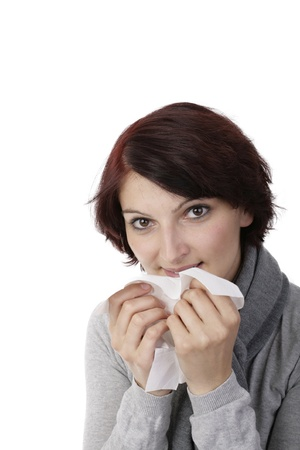 caught a cold young woman cleans the nose with tissue photo