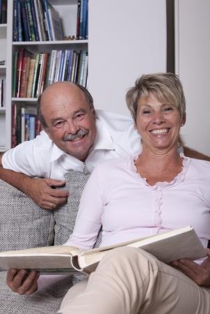 revel: happy couple with photo book Stock Photo