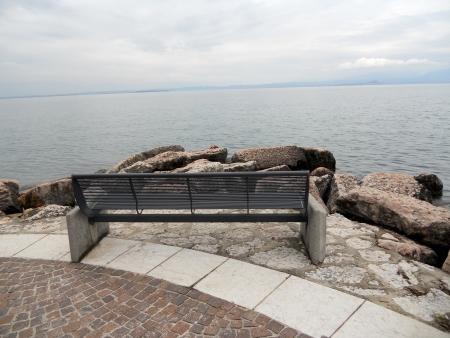 bench on lake photo