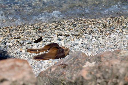 arbre: slippers on shore lake Stock Photo