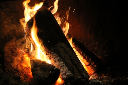 stone  fireplace: fire in the old stone fireplace