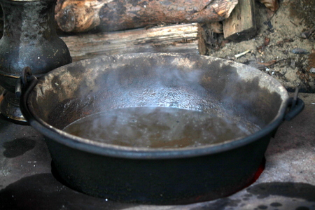 boiling water in the pot photo