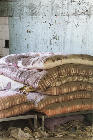mattress in abandoned hospital photo