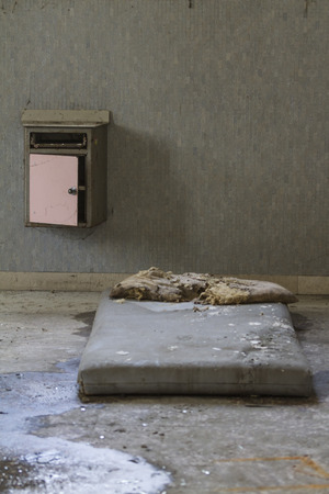 dirty room: mattress in abandoned hospital