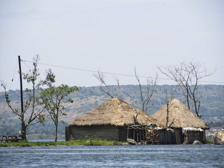 african hut on water photo