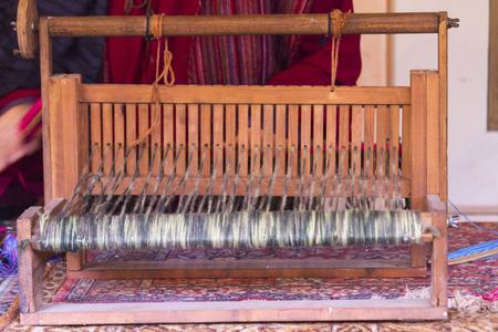 carding: old loom weaving Stock Photo