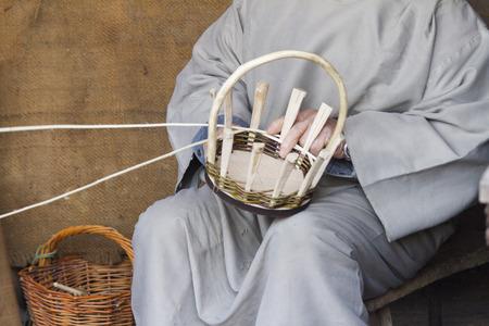 builds: craftsman who builds a basket