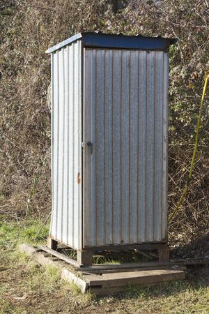 latrine: old latrine in the meadow