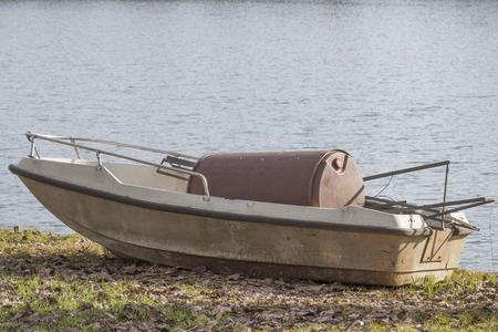 abandonment: abandoned boat on lake