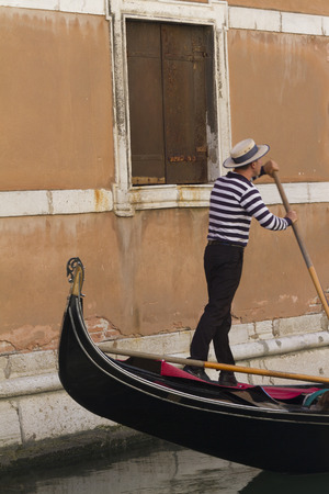 gondolier: gondola and gondolier with passengers in Venice Stock Photo