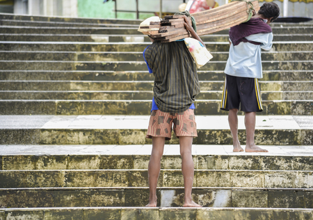 misery: people carrying weights