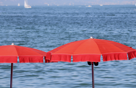 lake beach: beach umbrella at lake Stock Photo