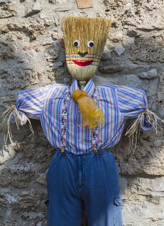 chaff: Stuffed man with broom Stock Photo