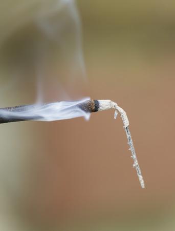 lit: lit incense smoking Stock Photo