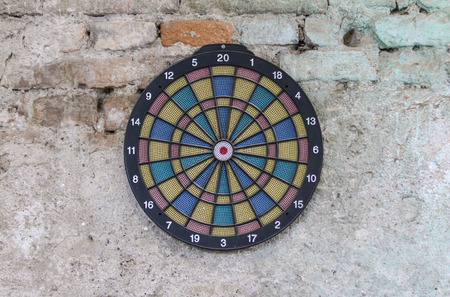 backlash: dartboard on old wall