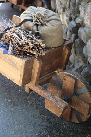 old wood farm wagon: medieval wheelbarrow