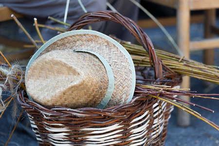 wicker work: handmade basket and hat Stock Photo