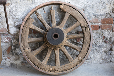 old wood farm wagon: old wooden wheel in the farm Stock Photo