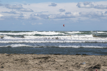 surfers: stormy sea with the wind surfers