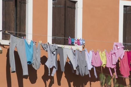 hung: clothes hung out to dry by the window