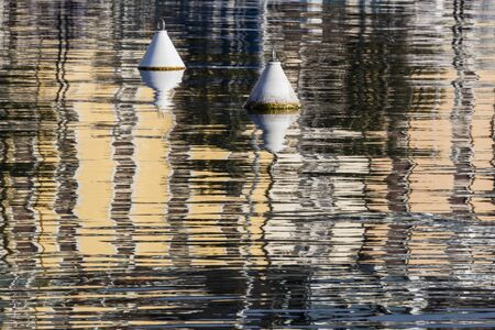 buoy: buoy and reflection on  lake Stock Photo