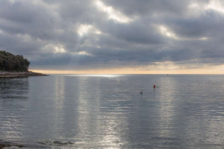 stormy sky and reflections on the placid sea Stock Photo