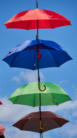 swaying: Umbrella hung in the wind Stock Photo