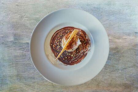 dessert with waffle, chocolate and hazelnuts Stock Photo