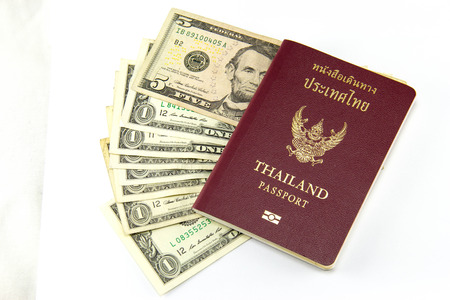 Thailand passport and the dollar. photo