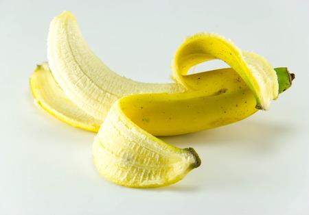 Peeled banana on white background. photo