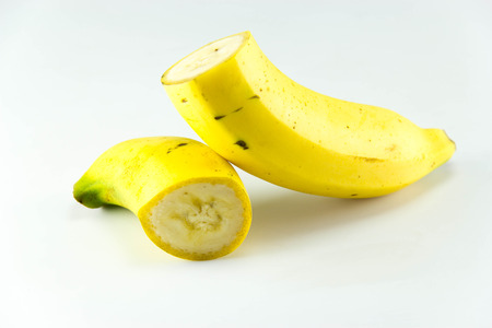 Cut Banana over white background. photo