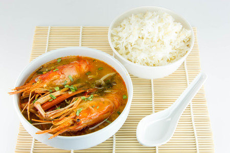 Tom Yum Goong,spicy soup with shrimp - Thai Cuisine on white background. photo
