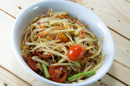 green papaya salad: Green papaya salad thai food style on wood background