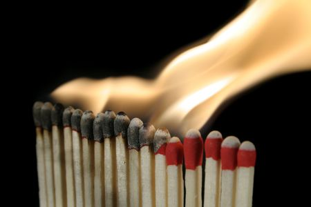 igniting: a row of igniting matches